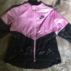 Pink and black Nike windbreaker .